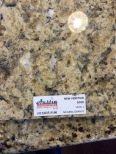 A warm gold colored granite countertop.